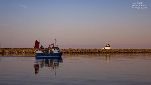 Værøy light house fishing boat